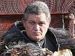 New Maori King Tuheitia Paki sits on the throne at his coronation at Turangawaeware Marae on August 21, 2006