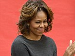 Flaunting her locks: The First Lady was also pictured yesterday sporting the new 'do at Yu Yung Public Charter School in Washington, D.C.
