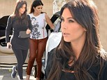 Kim Kardashian is dressed down for a change in trainers while sister Kourtney goes hell for leather as pair arrive at LA studio