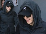 Back to reality! Make-up free Madonna wears a tracksuit as she leaves the gym after dripping in diamonds for her Oscars after-party