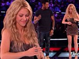 Dance-off: Usher and Shakira engaged in a dance-off on Tuesday on The Voice after lobbying for the same singer