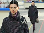 Her biggest coup to date! Kendall Jenner cements her model standing as she walks in Chanel's Paris Fashion Week show