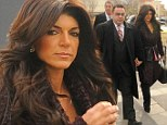 Time to face the judge: Teresa Giudice arrives to court with husband Joe sporting heavy make-up and bouffant hair as pair prepare to plead guilty to fraud charges
