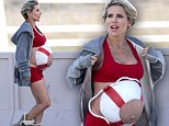 Playing it safe! Pregnant Elsa Pataky paints a life preserver on her burgeoning bare belly for a beach photo shoot