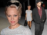 Well that's embarrassing! Pamela Anderson is chic in mini dress and boots but is shown up by scruffy husband Rick Salomon on dinner date