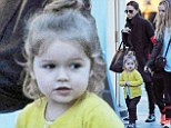 A little ray of sunshine! Harper Beckham wears a yellow cardigan to brighten up a day out with Victoria and Romeo