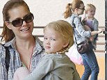 She lost the Oscar, but still has Aviana! Amy Adams carries her barefoot daughter into Creation Station