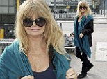 She's a Goldie girl: Actress Hawn looks radiant with perfectly preened hair as she touches down in London for charity event