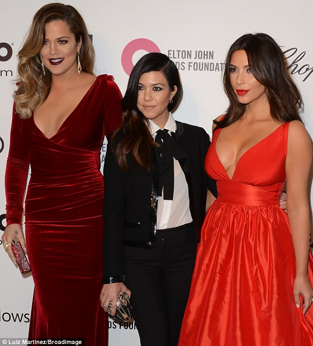 Outshining her sisters: Kourtney with Khloe and Kim at the Elton John Oscar viewing party on Sunday