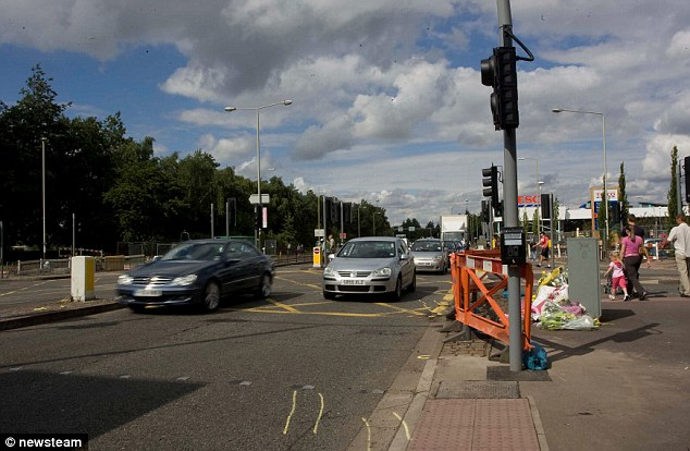 Scene: The two children were waiting with two adults at this junction in Leicester when they were hit by a car
