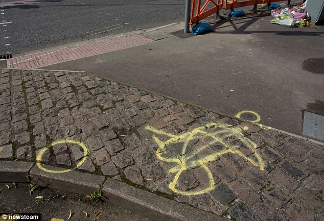 Scene: Marking on the pavement indicate where the children were struck as they waited in their pushchairs