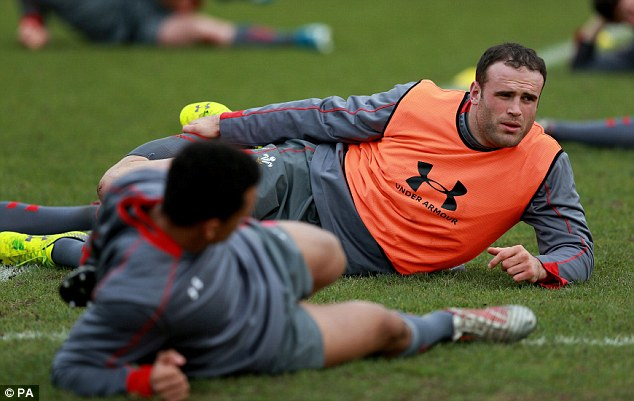 Lions den: Giant centre Jamie Roberts stretches out before Wednesday's training session
