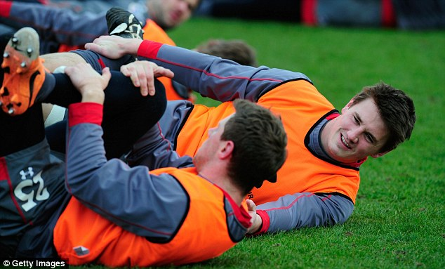 Partnership: Jonathan Davies (right) chats with fly-half Rhys Priestland during training at the Vale Hotel