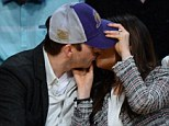 Get a room! The pair were seen stealing a kiss during the game
