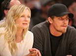 Basketball... Bring It On! Kirsten Dunst and boyfriend Garrett Hedlund concentrate on the match during sporty date night
