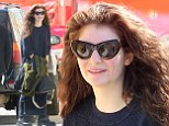 Lorde was spotted sporting looking grunge chic in a matching navy sloppy joe-like blouse and maxi skirt in Hollywood on Monday