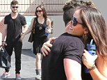 Bonding already! Danica McKellar and professional dance partner Val Chmerkovskiy share a laugh and hug after successful DWTS rehearsal