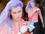 'It's temporary and fun!': Ireland Baldwin on her new purple mane as she steps out for the first time since dramatic dye job