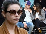 Ashton Kutcher and Mila Kunis 'haven't begun planning their wedding'... as it's revealed they've already been engaged for 'a couple of weeks'