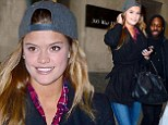 Well, that's different! Swimsuit model Nina Agdal covers up for a change