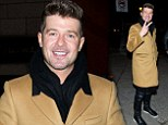 Robin Thicke pastes on a smile as he emerges from restaurant after attempts to win back wife Paula Patton fail