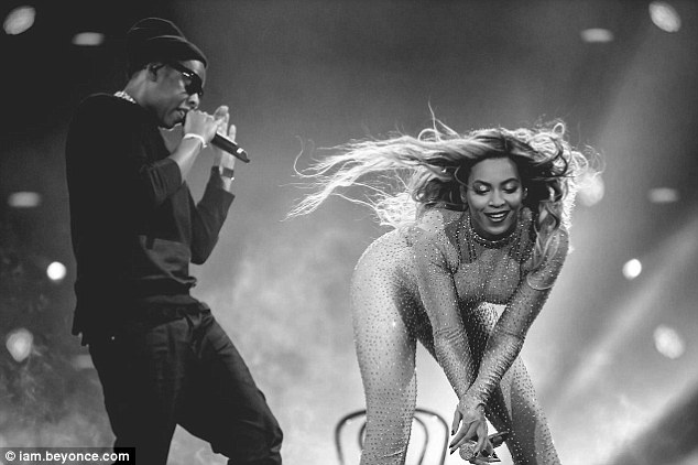 Getting some assistance: Jay Z joined his wife Beyonce for a racy portion of her performance in London