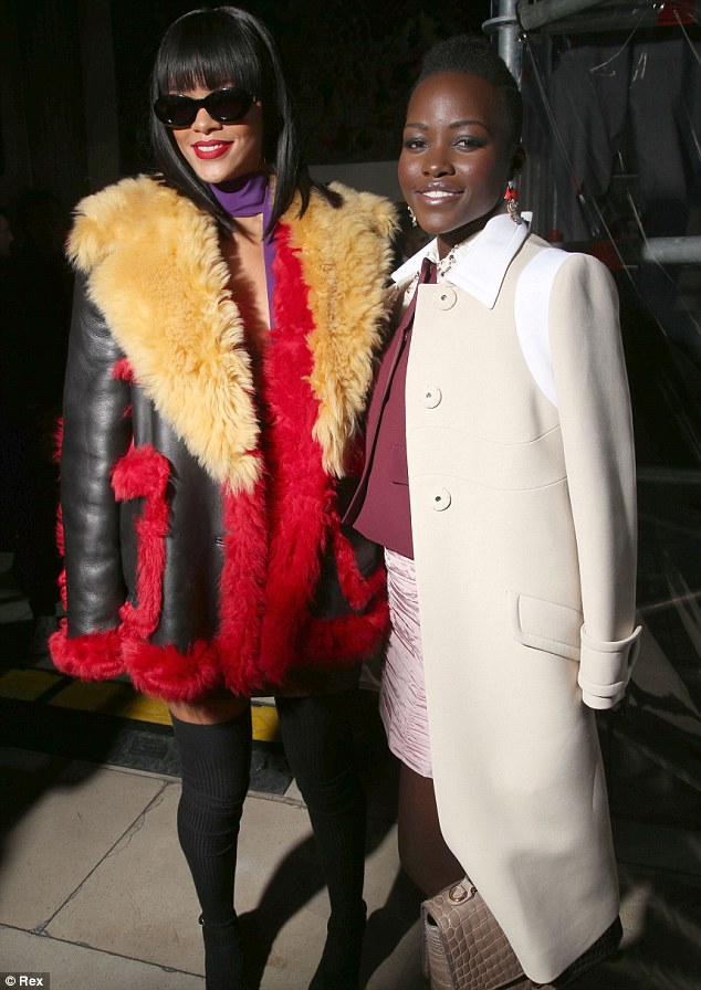 Different looks: The singer looked her usual eclectic self in a leather and fur coat in a multitude of colours while Lupita looked stylish in a white coat and skirt
