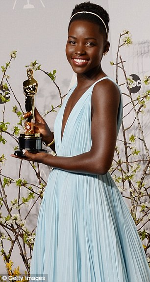 Big win: Lupita happily posed with her Oscar for Best Supporting Actress on Sunday