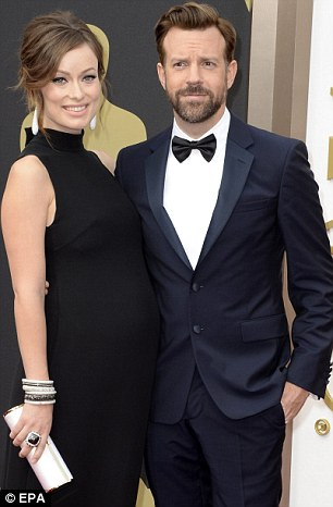 Glamour couple: Olivia looked stunning in a Valentino gown with fiancé Jason Sudeikis at the Oscars