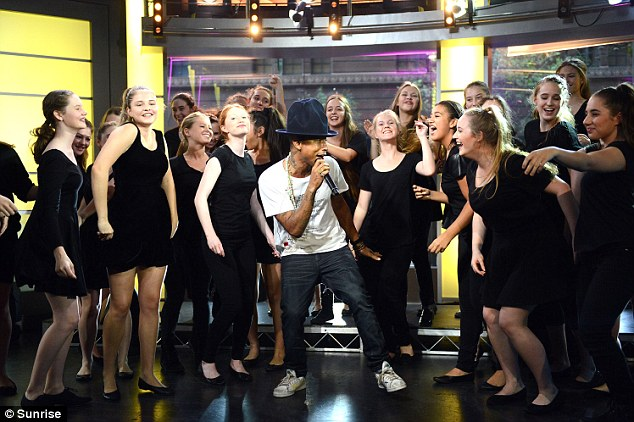 'Happy' Birthday: The singer-songwriter performed his hit song with The Australian Girls Choir, which will celebrate its 30th birthday on Friday