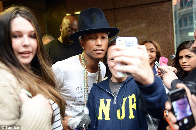 Meet and greet: Pharrell posed for pictures with fans at Sydney's Martin Place