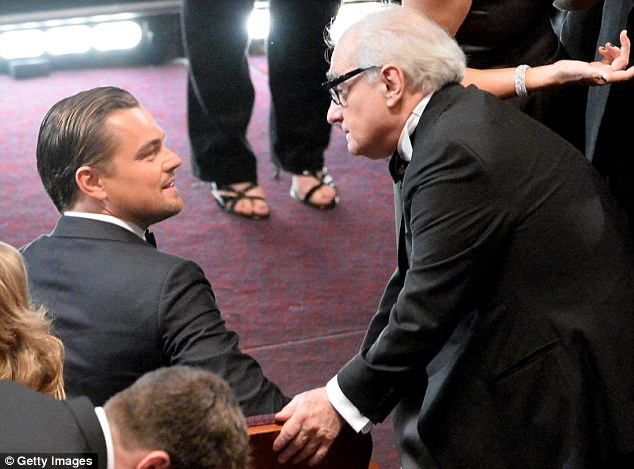 He's A-list: Talking with his Wolf Of Wall Street director while at the Academy Awards