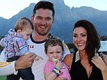 Still smiling: Smith looked content with his family despite defeat