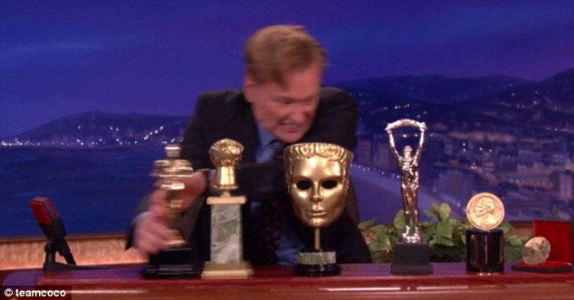 It's better than all these awards! Conan swept replicas of an Oscar, Emmy and Bafta to one side before making his announcement