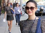 Emmy Rossum styles up her snakeskin leather skirt while out and about in Beverly Hills