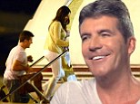 'I was born to be a dad... it would be cool to have two or three!': Simon Cowell admits he's hooked on fatherhood as he heads to London to introduce Eric to his family