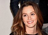 Bling alert! Leighton Meester flashes her wedding ring for the first time since she secretly married Adam Brody