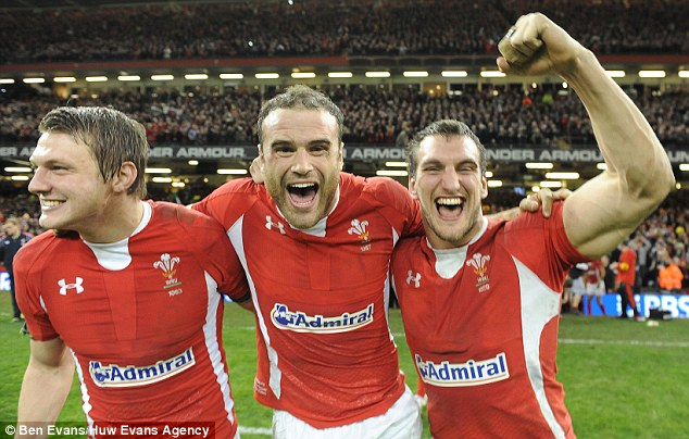 Winning ways: Dan Biggar, Jamie Roberts and Sam Warburton of Wales celebrate last year's Six Nations victory over England