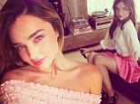 Pretty in pink! Miranda Kerr is flirty in a bright mini skirt as new face of H&M gives sneak peek at new Spring/Summer range