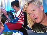Jessica Simpson's dad Joe giggles as flamboyant reality star Andre Soriano sits on his lap and strokes his chest