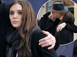 She could be next! Elizabeth Olsen puts on affectionate display with boyfriend Boyd Holbrook in Paris... after sister Mary-Kate's recent engagement