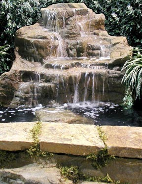 Rock Waterfall In Pond