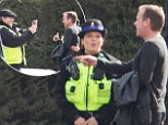 Everyone's a Jack Bauer fan! Kiefer Sutherland is stopped for a picture with a policewoman on 24: Live Another Day set