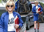 Rita Ora carries bizarre quilted jacket bag as she runs errands in Los Angeles in baseball inspired jacket and skirt