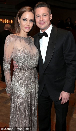 Supportive partner: Jolie pictured with Brad Pitt at the Academy Awards on Sunday