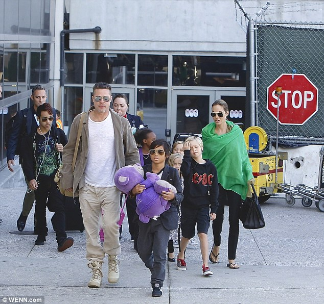 Big family: Brad and Angelina pictured with Shiloh, Maddox, Pax, Zahara, Vivienne, and Knox in Los Angeles in February