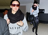 Chic: New Top model Kendall Jenner arrives at LAX after Paris fashion shows