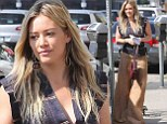 Not feeling the same way? Hilary Duff looks down as she steps out after ex Aaron Carter vows to 'get her back' on Twitter