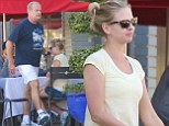 Still early days? Kelsey Grammar's wife Kayte hides belly beneath loose-fitting top following rumours she is pregnant