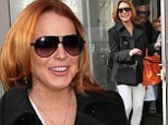 Orange appeal! Lindsay Lohan's casual outfit gets a boost with $15k Hermes Birkin bag ahead of Tonight Show appearance